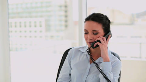Happy businesswoman talking on the phone Footage