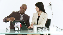 Businessman and woman discussing a project Footage