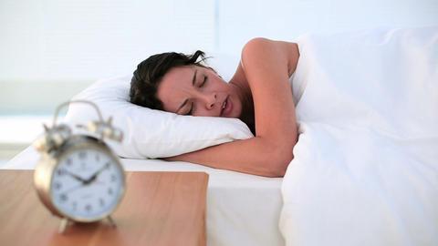Brunette sleeping peacefully in bed Footage