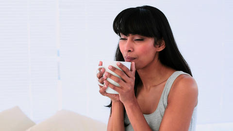 Attractive woman enjoying her morning coffee on he Footage