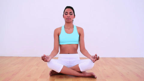 Calm woman meditating in lotus position Footage