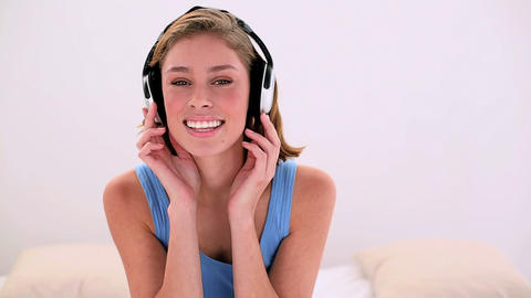 Happy brunette listening to music Footage