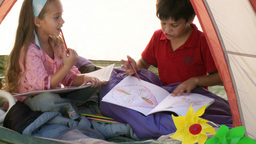 Two children in tent playing Footage