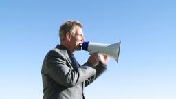 Businessman giving instruction through a megaphone Footage