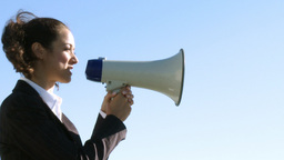 Businesswoman with a megaphone Live Action