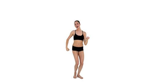 Dynamic brunette in sportswear dancing Footage