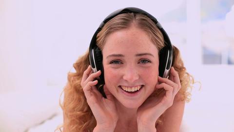Cute blonde model enjoying music Footage