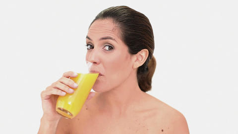 Pretty brunette woman enjoying orange juice Footage