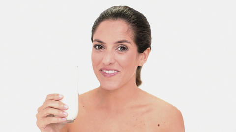 Beautiful brunette woman enjoying milk Footage