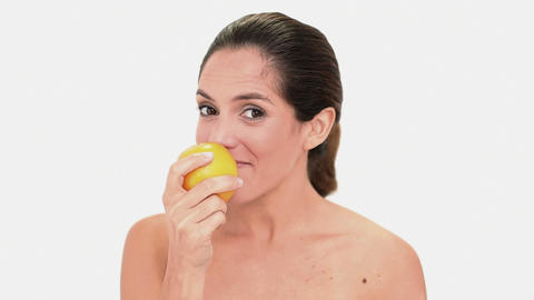 Calm brunette woman holding and smelling an orange Footage