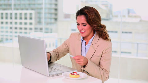 Smiling attractive businesswoman buying online wit Footage