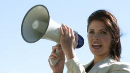 Businesswoman giving instruction via megaphone 2 Footage