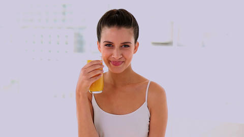 Joyful beautiful woman enjoying orange juice Footage