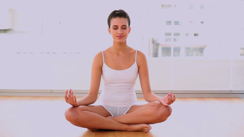 Peaceful Beautiful Woman Relaxing In Yoga Position stock footage