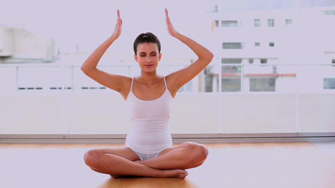 Calm Beautiful Woman Relaxing In Yoga Position stock footage