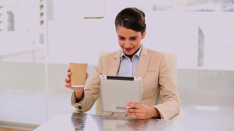 Smiling beautiful businesswoman using a laptop whi Footage