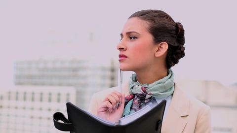 Stylish beautiful woman writing on a diary Footage