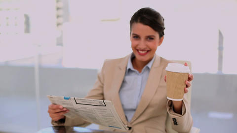 Relaxed beautiful businesswoman drinking coffee wh Footage
