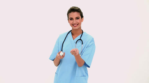 Pleased Beautiful Nurse Emptying A Medication Box stock footage