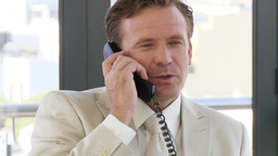 Powerful businessman on a phone Live Action