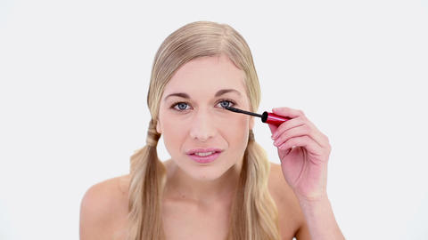 Happy nude blonde applying mascara Footage
