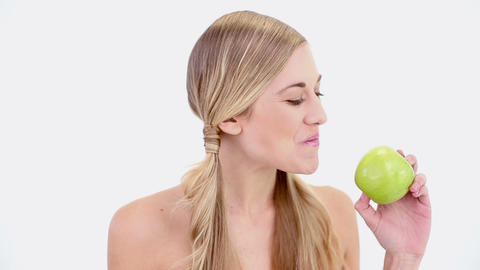 Happy nude blonde holding green apple Footage