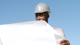 Responsible architect looking at a blueprint plan Footage