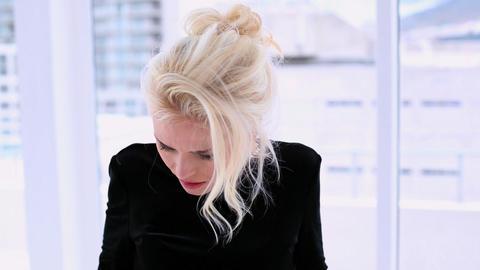 Beautiful blonde woman having headache Footage