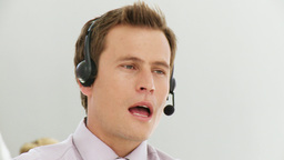 Smart business man giving advice via headset Footage