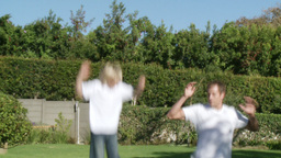 Father and son Jumping on a trampoline Footage