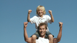 Athletic Father with his son on his shoulders show Footage