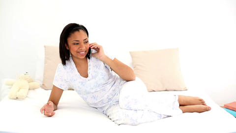 Smiling attractive woman phoning with her smartpho Footage