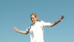 Attractive Woman jumping on a trampoline Footage