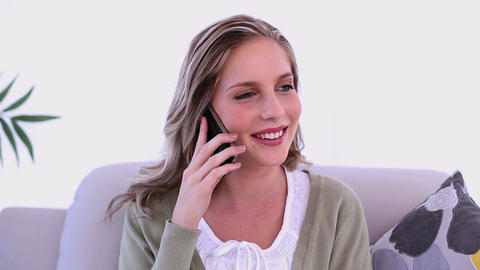Happy woman phoning with her smartphone sitting on Footage