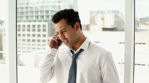 Excited handsome businessman phoning Footage