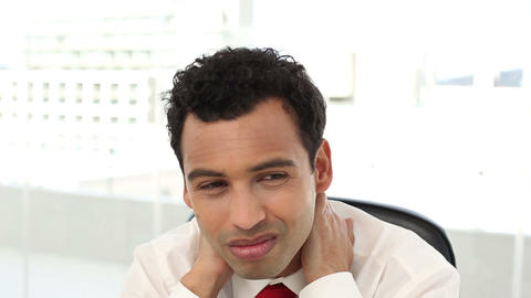 Frowning handsome businessman having neck pain Live Action