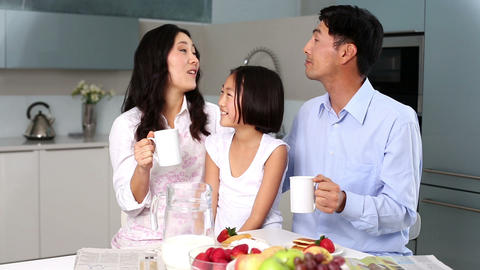 Happy family standing in kitchen Footage