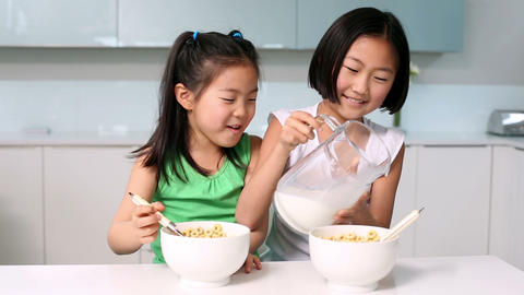 Two girls eating cereal Footage