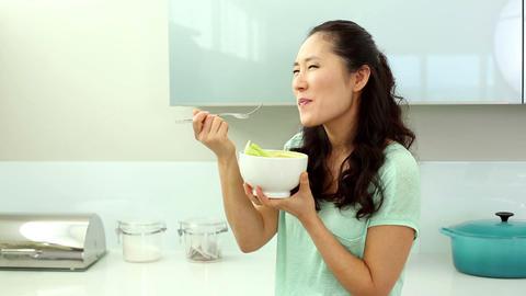 Smiling woman eating salad Footage