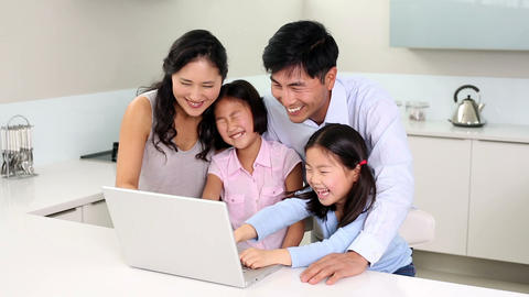 Happy family using laptop together Footage