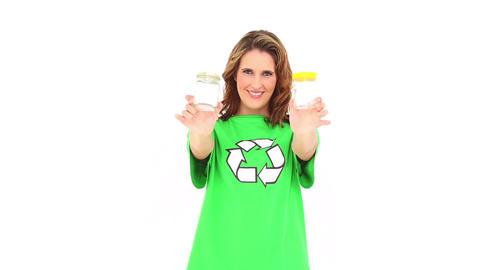 Smiling environmental activist showing jars Footage