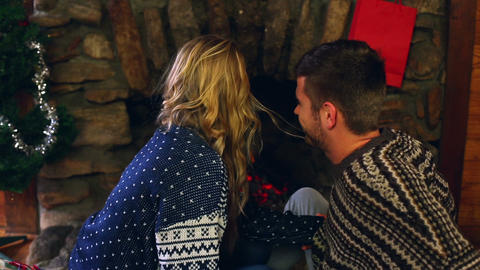 Cute couple celebrating christmas together in fron Footage