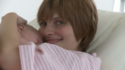 Happy young mother with her baby in a hospital Footage