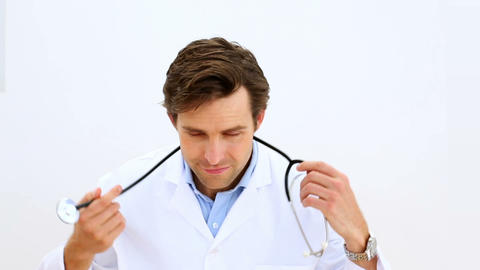 Doctor taking off and putting on stethoscope Footage
