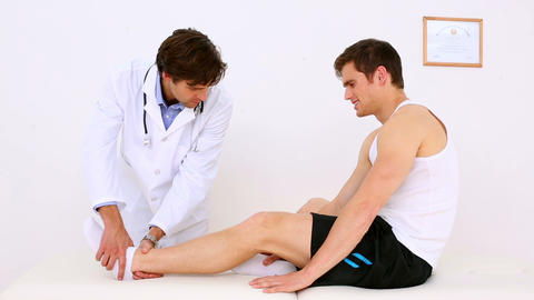 Doctor checking patients injured ankle Footage