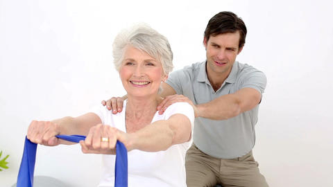Physiotherapist Checking Senior Patients Shoulder  stock footage