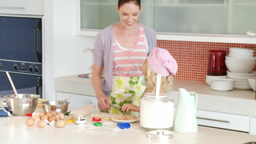 Mother and daughter baking together Footage