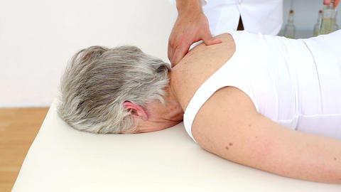 Doctor massaging senior patients shoulders Footage