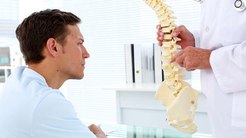 Patient listening to his doctor explain spine mode Footage