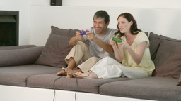 Happy couple playing a video game Footage